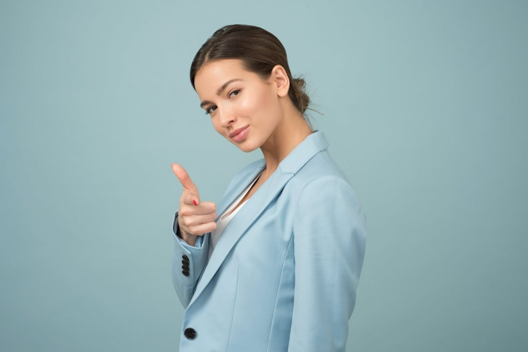 woman wearing blue shawl lapel suit jacket